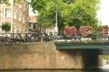 Flowers along canal bridge